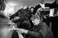 Nino's grandmother plays piano at her wedding. Tbilisi. 2006.