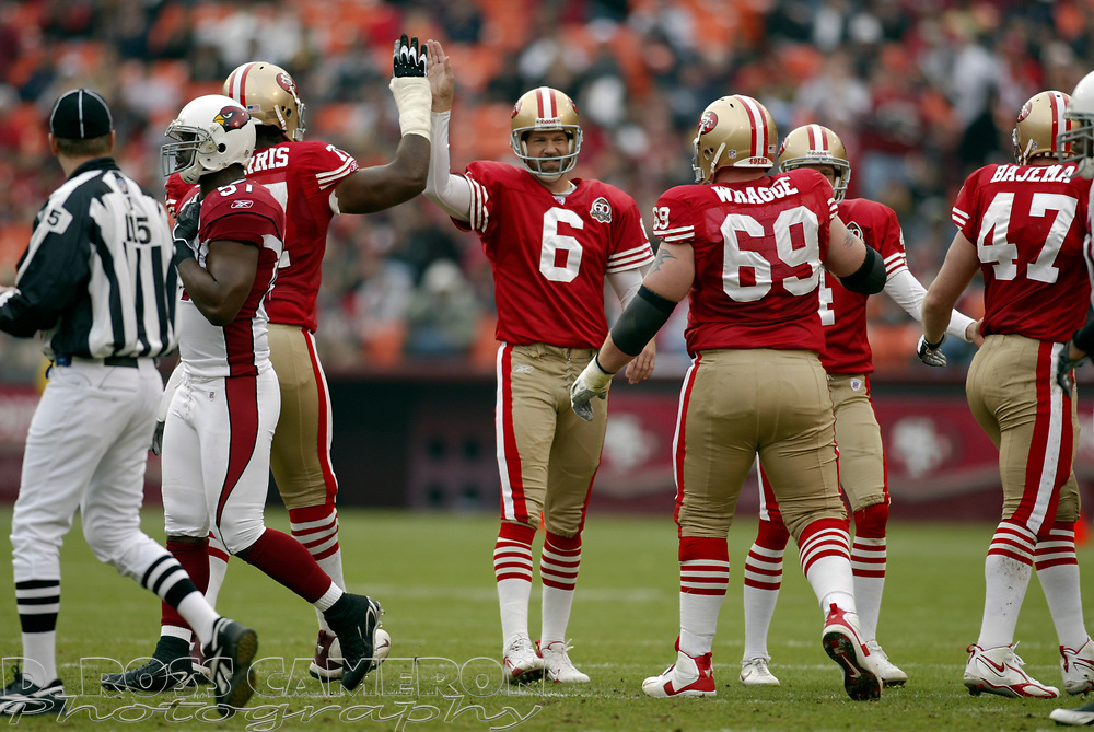San Francisco 49ers kicker Joe Nedney is congratulated by his teammates after kicking a 49-yard field goal against the Arizona Cardinals during the first quarter of an NFL football game, Sunday, Dec. 24, 2006 at Candlestick Park in San Francisco. The Cardinals won, 26-20. (D. Ross Cameron/The Oakland Tribune)