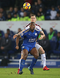 Leicester City's Wes Morgan (front) and Burnley's Ashley Barnes battle for the ball
