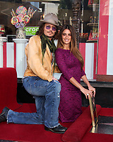4/1/2010 Penelope Cruz is joind by Johnny Depp during her Hollywood Walk of Fame ceremony