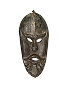 A wooden mask made by the Taliang people, a sub-group of the Ta'Oy in Saravanh province, Lao PDR. Originally used for ritual puposes and worn by villagers for New Year and harvest festivals, the masks are now mainly sold to tourists.