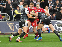 Rugby Union - 2018 / 2019 - European Champions Cup Qualification Final - Ospreys vs Scarlets<br /> <br /> Johnny McNicholl,of Scarlets  tackled by Hadleigh Parkes, of Scarlets… at the Liberty Stadium<br /> <br /> Credit: COLORSPORT/WINSTON BYNORTH