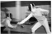 Pupils aquare off at Santelli's Salle D'arms, a school of French fencing that has been in business for over 50 years , at 40 West 27th Street. December 14th 1992© Copyright Photograph by Dafydd Jones 66 Stockwell Park Rd. London SW9 0DA Tel 020 7733 0108 www.dafjones.com