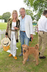 PATTIE BOYD and ROD WESTON with their dog Freddie at the Flannels for Heroes Cricket tournament in association with Dockers in aid of the charities Walking With The Wounded, On Course Foundation and Combat Stress held at Burton Court, London on 20th June 2014.