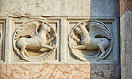 Medieval relief sculptures of mythical griffins on the exterior of the Romanesque Baptistery of Parma, circa 1196, (Battistero di Parma), Italy .<br /> <br /> If you prefer you can also buy from our ALAMY PHOTO LIBRARY  Collection visit : https://www.alamy.com/portfolio/paul-williams-funkystock/romanesque-art-antiquities.html<br /> Type -     Parma    - into the LOWER SEARCH WITHIN GALLERY box. <br /> <br /> Visit our ROMANESQUE ART PHOTO COLLECTION for more   photos  to download or buy as prints https://funkystock.photoshelter.com/gallery-collection/Medieval-Romanesque-Art-Antiquities-Historic-Sites-Pictures-Images-of/C0000uYGQT94tY_Y