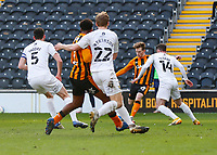 Hull City's Keane Lewis-Potter shoots and scores his side's first goal  in the 22nd minute despite the attentions of Oxford United's Anthony Forde<br /> <br /> Photographer Lee Parker/CameraSport<br /> <br /> The EFL Sky Bet League One - Hull City v Oxford United - Saturday 13th March 2021 - KCOM Stadium - Kingston upon Hull<br /> <br /> World Copyright © 2021 CameraSport. All rights reserved. 43 Linden Ave. Countesthorpe. Leicester. England. LE8 5PG - Tel: +44 (0) 116 277 4147 - admin@camerasport.com - www.camerasport.com