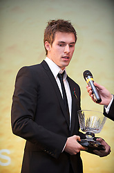 CARDIFF, WALES - Wednesday, November 11, 2009: Wales' Aaron Ramsey with the Young Welsh Player of the Year trophy during the Football Association of Wales Player of the Year Awards hosted by Brains SA at the Cardiff City Stadium. (Pic by David Rawcliffe/Propaganda)