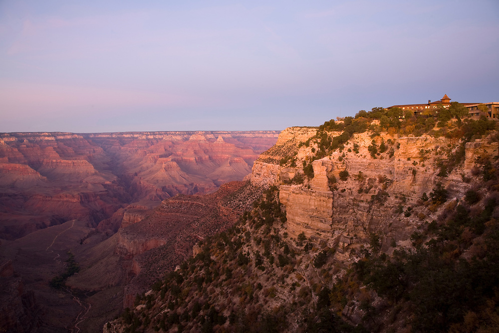 Scenic image of El Tovar Hotel and the Grand Canyon at sunset from the South Rim of the Grand Canyon.