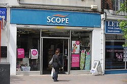 © London News Pictures. 14/07/2013. COPY AVAILABLE BELOW…. Scope charity shop on Orpington High Street, Kent. Orpington High street now has 12 charity shops  in one short stretch, with Cancer Research UK having two shops on different sides of the high street almost facing each other.  COPY AVAILABLE HERE:  http://tinyurl.com/nhtxtyd<br /> <br /> Photo credit :Grant Falvey/LNP