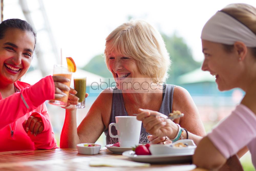 Smiling Women Having Breakfast