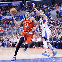 24 March 2014: Milwaukee Bucks guard Giannis Antetokounmpo (34) drives past Los Angeles Clippers forward Matt Barnes (22) during the Los Angeles Clippers 106-98 victory over the Milwaukee Bucks at the Staples Center, Los Angeles, California, USA.