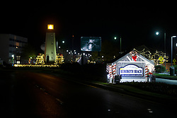 Christmas decor lights up the night by the Henlopen lighthouse replica on Rehoboth Avenue, in a time exposure Monday, Nov. 26, 2018 in Rehoboth Beach, Del. (Photo by D. Ross Cameron)