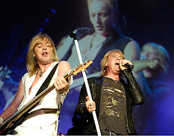 Def Leppard play thier home town of Sheffield at the Hallam FM Arena one of only two UK dates - Rick Savage & Joe Elliott.17 June 2006.Copyright Paul David Drabble