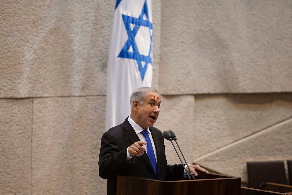 Israel's Prime Minister Benjamin Netanyahu gestures as he speaks during a special session marking a year since the passing of former Prime Minister of Israel Yitzhak Shamir, at the Knesset, Israel's parliament in Jerusalem, on July 9, 2013.