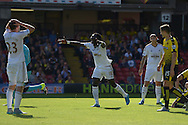 Bafetimbi Gomis of Swansea City appeals to Referee Bobby Madley for a decision to award Watford a goal kick. Barclays Premier League, Watford v Swansea city at Vicarage Road in London on Saturday 12th September 2015.<br /> pic by John Patrick Fletcher, Andrew Orchard sports photography.