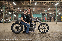 Sigourney Wells and Joey Brookshier, owner of Oak City Speed, a bike shop / DIY shop in Raleigh, here on his 1965 BSA Spitfire drag  bike built in 2-weeks for the Congregation Show in Charlotte, NC. USA. Friday April 13, 2018. Photography ©2018 Michael Lichter.