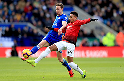 Manchester United's Jesse Lingard (right) and Leicester City's Jonny Evans battle for the ball during the Premier League match at the King Power Stadium, Leicester.