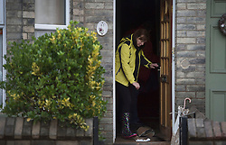 © Licensed to London News Pictures. 29/12/2015. York, UK.  A resident stands in the doorway of her flooded property in Huntingdon Road in York on December 29, 2015. Further rainfall is expected over coming days as Storm Frank approaches the east coast of the country. Photo credit: Ben Cawthra/LNP