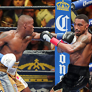 """Peter """"Kid Chocolate"""" Quillin punches J'Leon Love during a Premier Boxing Champions fight on Saturday, August 4, 2018 at the Nassau Veterans Memorial Coliseum in Uniondale, New York.  (Alex Menendez via AP)"""