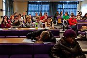Boy fallen asleep during a lecture at De Montfort University, Leicester, UK.