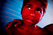 Holi festival, India, on wednesdayday, mar. 11, 2009. A litlle boy rest between the colorfights