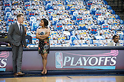 Amanda Green, basketball operations coordinator for the Oklahoma City Thunder, visits with Sam Presti, the teams general manager, during warmups before a playoff game against the Dallas Mavericks in Dallas, Texas on April 21, 2016. (Cooper Neill for The New York Times)