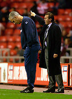 Photo. Jed Wee.<br /> Sunderland v Huddersfield Town, Carling Cup 2nd Round, Stadium of Light, Sunderland. 23/09/2003.<br /> Huddersfield manager Peter Jackson (R) urges his players on to greater heights as Sunderland manager Mick McCarthy hangs his head.