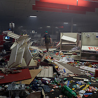 Protesters loot and burn the Target store  near the Minneapolis Police third precinct after a white police officer was caught on a bystander's video pressing his knee into the neck of African-American man George Floyd, who later died at a hospital, in Minneapolis, Minnesota, U.S. May 28, 2020. REUTERS/Adam Bettcher