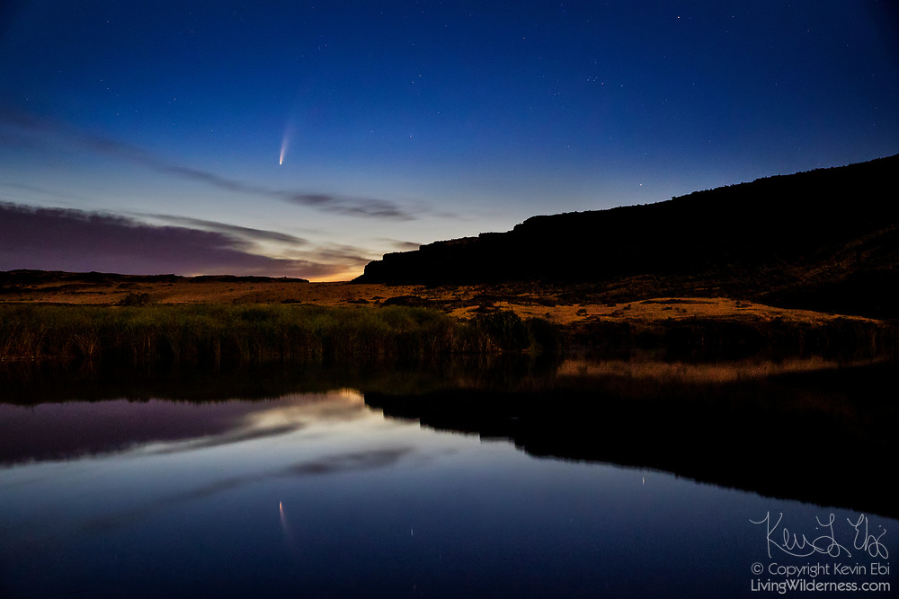 Comet C/2020 F3 (NEOWISE) shines in the sky above the Columbia National Wildlife Refuge near Othello, Washington, casting its reflection onto McMannaman Lake. Comet NEOWISE is a long-period comet and its current orbital path will take about 6,800 years to complete. Its nucleus is about 3 miles (5 kilometers) across and is covered with sooty, dark particles left over from its formation near the birth of our solar system 4.6 billion years ago.