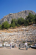 Archaeological site ruins of Ancient Greek city Priene, Turkey, 1997 tourist group in amphitheatre