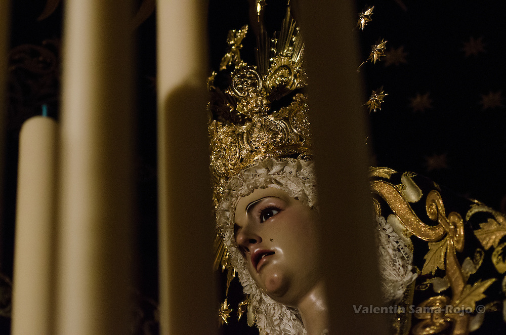 Detail of the face of the Virgin 'Maria Santisima Inmaculada Madre de la Iglesia', carving made by Juan Manuel Miñarro at the 20th century. She is wearing a golden crown and black and gold dress.