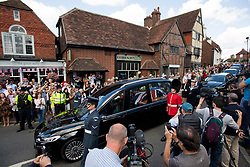 © Licensed to London News Pictures. 10/07/2020. London, UK. Large crowds gather in the town of Ditchling, East Sussex, to pay their respects as the coffin of Dame Vera Lynn passes through the town ahead of the funeral. The 'Forces' Sweetheart', who died last month aged 103, was famous for singing performances during WW2, which helped raise morale amongst troops abroad. Photo credit: Ben Cawthra/LNP