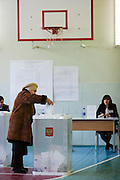 Moscow, Russia, 04/03/2012..A woman casts her ballot on a basketball court as Russians vote in the Presidential election, which Prime Minister Vladimir Putin is expected to win in the first round.