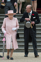 RETRANSMITTING CORRECTING NAME Queen Elizabeth II and the Duke of Edinburgh during a garden party at Buckingham Palace in London.