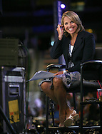 Katie Couric reports at the Democratic Convention in Denver, Colorado on August 25,2008. Photograph by Dennis Brack