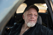 """Kelly Boyer, 49, a former construction worker whose rented trailer in Paradise was destroyed, in the car that was donated to him. He, too, has not filed a claim against PG&E. """"I'm wondering if it's worth the effort,"""" he said. Salgu Wissmath for The New York Times"""