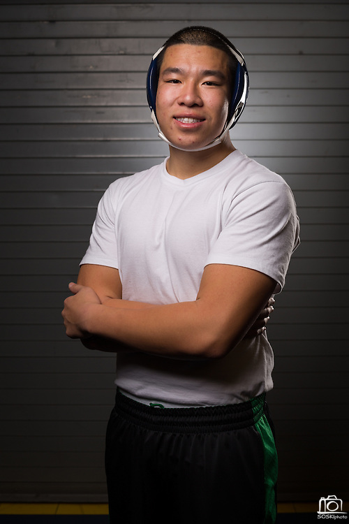 Senior Thomas Dao poses for a portrait during wrestling practice at Milpitas High School in Milpitas, California, on December 11, 2015. (Stan Olszewski/SOSKIphoto)