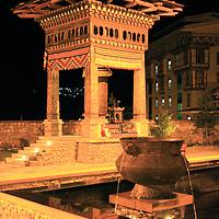 Asia, Bhutan, Thimpu. Exterior and Prayer Wheel at Taj Tashi in Thimpu, Bhutan.