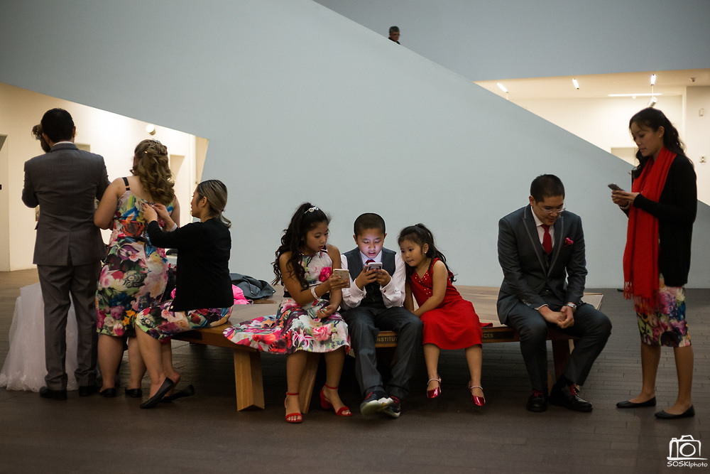 Bride and groom celebrate their wedding with family and friends at the de Young Museum in San Francisco, California, on November 26, 2016. (Stan Olszewski/SOSKIphoto for Scott MacDonald)