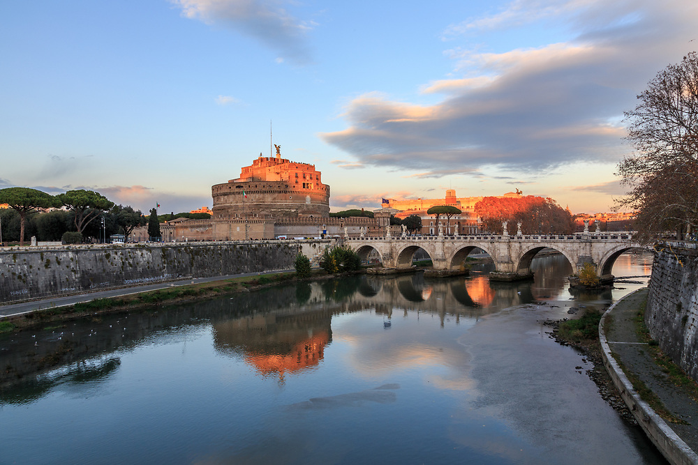 The Mausoleum of Hadrian or Castel Sant'Angelo lies on the shore of river Tiber in Rome, Italy. First Castel Sant'Angelo was the mausoleum of the Roman Emperor Hadrian and his family. Later the popes used it as a castle, fortress, and prison. The famous prisoners were, for example, Giordano Bruno and the sculptor and goldsmith Benvenuto Cellini.