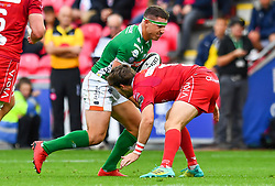 Luca Morisi of Benetton Treviso is tackled by Dan Jones of Scarlets<br /> <br /> Photographer Craig Thomas/Replay Images<br /> <br /> Guinness PRO14 Round 3 - Scarlets v Benetton Treviso - Saturday 15th September 2018 - Parc Y Scarlets - Llanelli<br /> <br /> World Copyright © Replay Images . All rights reserved. info@replayimages.co.uk - http://replayimages.co.uk