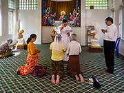 28 NOVEMBER 2017 - YANGON, MYANMAR: The parish priest marries an elderly Burmese couple  in a chapel at St. Francis of Assisi Church in Yangon. About 1,500 people are camping at the church before the papal mass at Kyaikkasan Sports Ground, about three kilometers from the church.   PHOTO BY JACK KURTZ