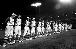 HISTORICAL NIGHT: The Oakland Athletics line up along the third baseline before their first home game at the Oakland-Alameda County Coliseum in Oakland, April 17, 1968. 50,164 fans along with Hall of Famer Joe DiMaggio (far left) were in attendance as the A's lost to the Baltimore Orioles 4-1. <br /> (photo by Ron Riesterer/Oakland Tribune)