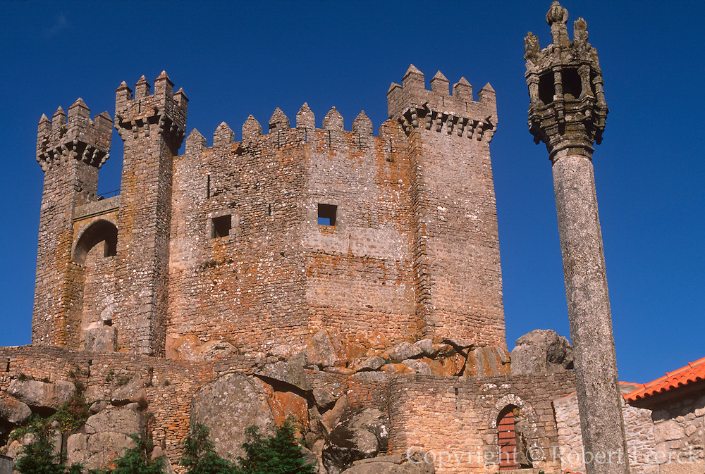 PORTUGAL, EAST/CENTRAL  castle keep rises above a ring of walls  in the medieval town of Penedon, north  of Guarda