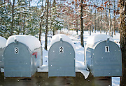 A row of snow covered mailboxes in a rural area in Arkansas.