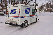 Merrick, New York, U.S. January 3, 2014. A United States Postal Service USPS truck delivers mail as a dangerous deep freeze settles in, after a blizzard dumped 6-12 inches of snow on Long Island. The temperature range is 13 to 18 degrees Fahrenheit (-11° to -8° Celsius), with wind gusting up to 45 mph. Wind chill factors make it between 5° F to -10° F (-15° to -23° C), with record lows expected at night.