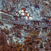 A tibetan Buddhist gompa rises above stone houses in Braga, Nepal, north of the Annapurna massif.