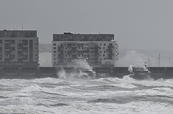 © Licensed to London News Pictures. 30/07/2021. Brighton, UK. Waves hit the marina in windy conditions at Brighton, East Sussex. Parts of the south are feeling the effects of Storm Evert, the first named storm of summer 2021. Photo credit: Peter Macdiarmid/LNP