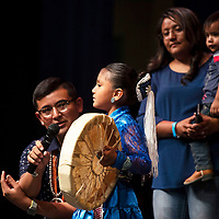 Shanoah Largo, 5, Navajo, performs during the talent portion of the Tiny Tot Pageant while her mom stands nearby, Monday, August 6, 2018 at the El Morro Theatre.