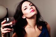 USA, Oregon, Springfield, Young Woman enjoying a glass of wine. MR